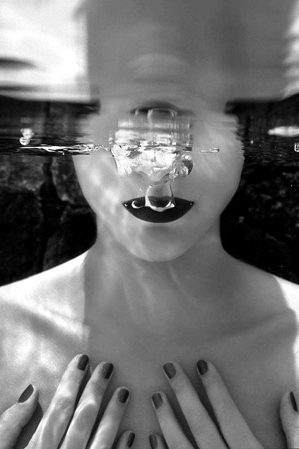 by Michael Leis. This image is different to most images I have seen, instead of capturing the whole of the model in the image the photographer has focused more on her body and the air bubbles rising to the surface of the water. The monochrome affect makes it look nicer than it would in colour.