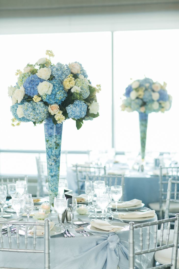 Blue Hydrangea and White Rose Centerpieces | Sarah Tew Photography https://www.theknot.com/marketplace/sarah-tew-photography-long-island-city-ny-312195