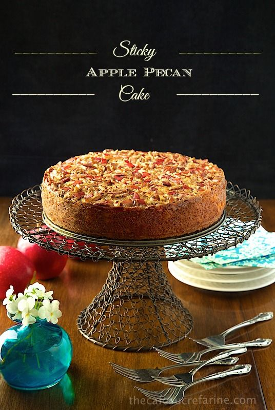 Sticky Apple Pecan Cake - this moist, buttery autumn-inspired confection is loaded with apples in the fabulous warm-spiced cake, as well as adorning the luscious pecan topping. Just before it emerges from the oven, it's brushed with a sweet, sticky, maple glaze, making it beyond irresistible!