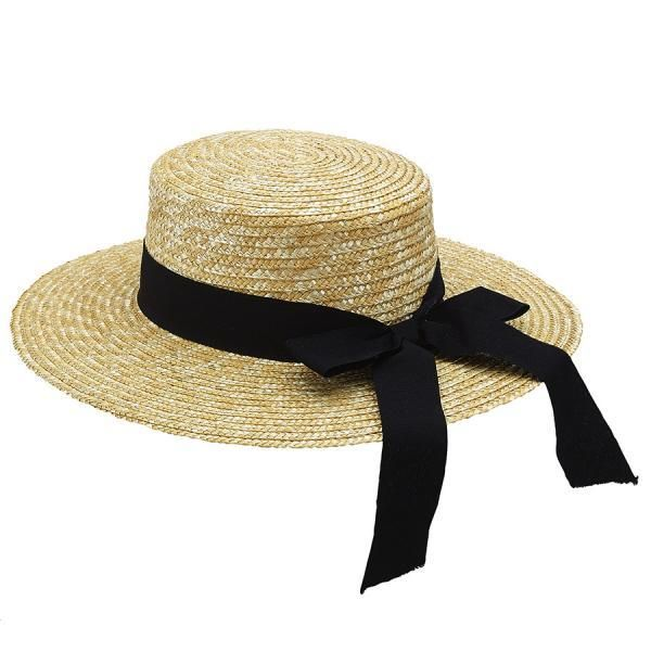 Gondola vintage inspired women s boater hat in a natural straw weave with a  black hatband. e7d1ff556