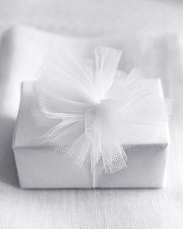 tulle-wrapped gift, I do this for Christmas gifts all the time! Looks great!