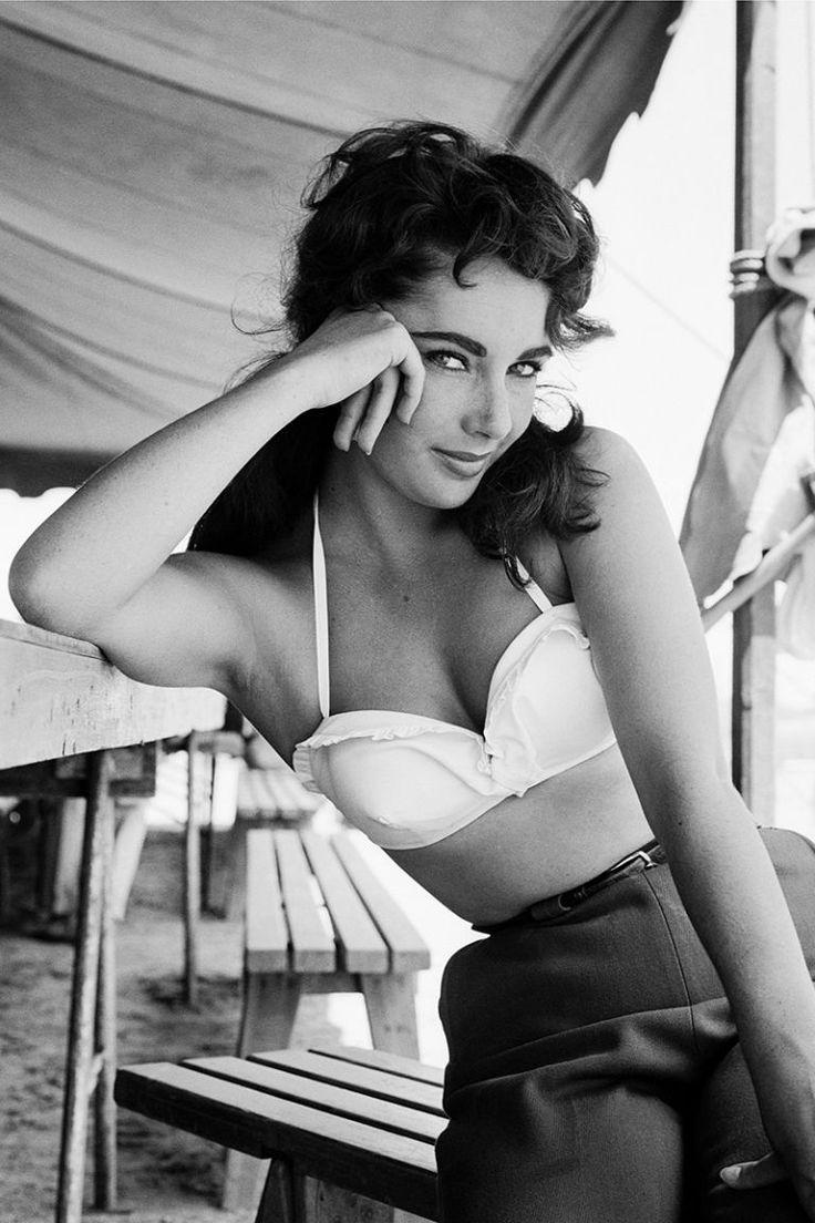 Elizabeth Taylor on the Giant set, 1956. See 51 more rare, vintage photos of celebrities enjoying summer.
