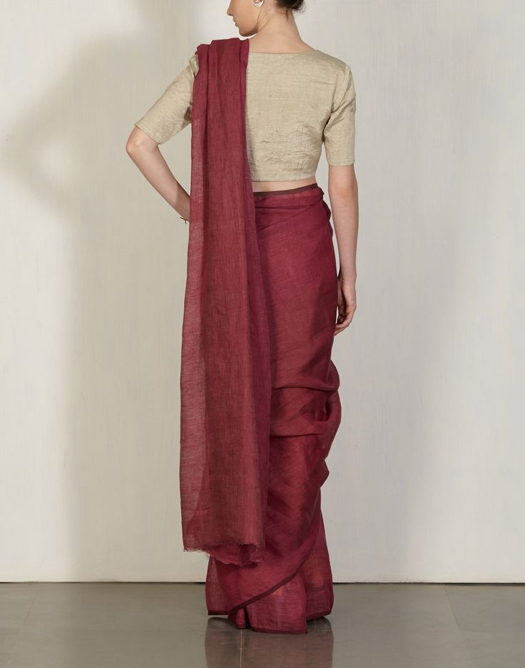 Anavila is known for her simple and elegant light linen saris that drape beautifully. This one is a beetroot yarn dyed sari in her trademark handwoven linen.