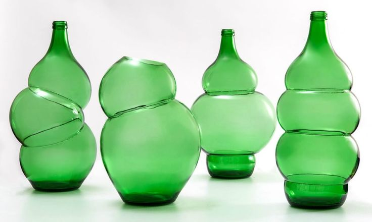 Klaas Kuiken, uses his own glass-blowing technique to warp everyday green glass bottles into beautiful, unique vases.