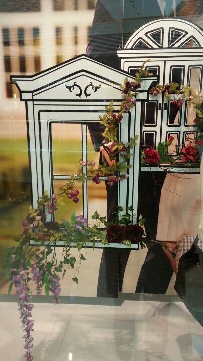 Window display with flowers- what a sweet idea..we could hang jewellery from the windows