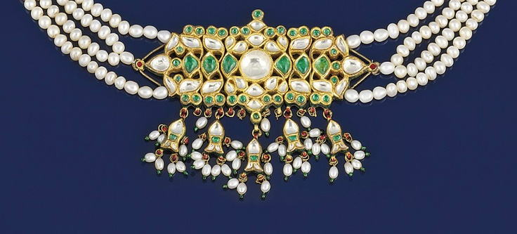 An emerald, colourless sapphire, enamel and cultured pearl necklace