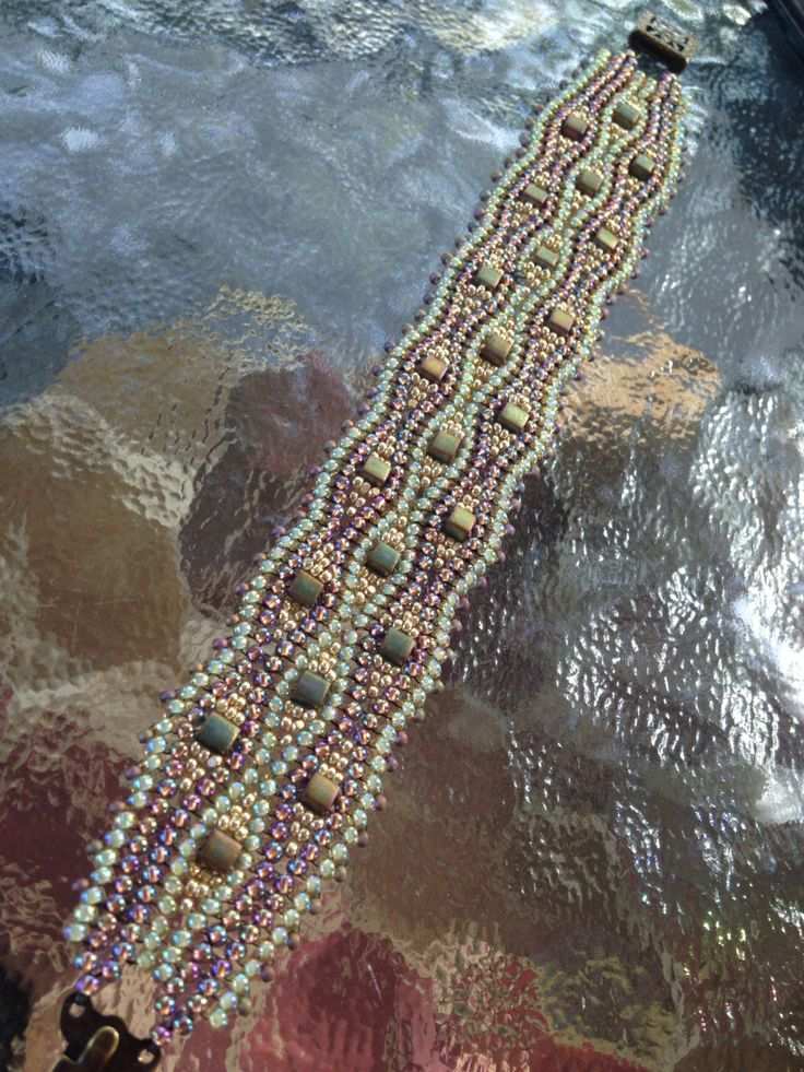 A personal favorite from my Etsy shop https://www.etsy.com/listing/212849739/green-and-amethyst-herringbone-waves