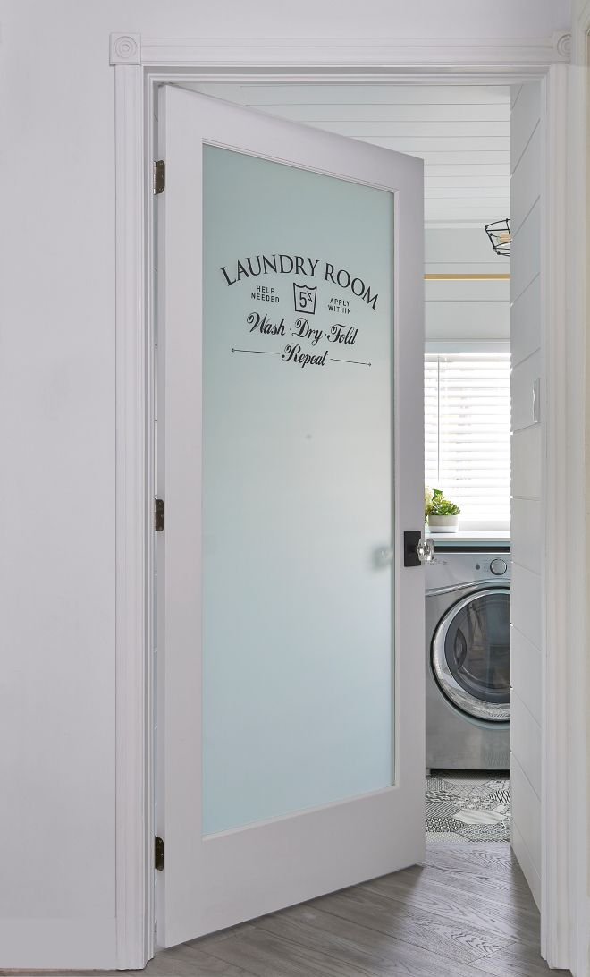 Laundry room door. Laundry room door ideas. Adding a frosted glass door to a laundry room is always a smart idea; especially for those busy week days where piles of laundry is being done. The door keeps the noise contained and any mess out of sight. Glass and stencil Laundry room door #Laundryroomdoor #Laundryroom Soda Pop Design Inc.