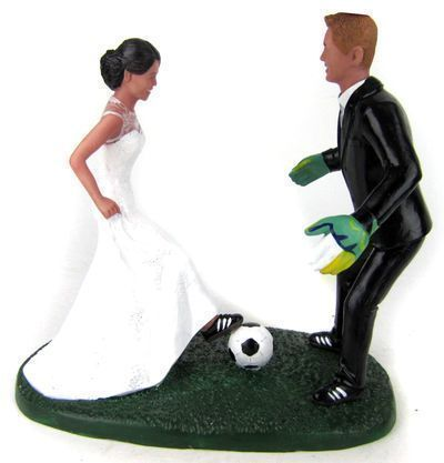Custom sculpted bride and groom soccer player wedding cake topper. Custom sculpted to look like the bride and groom!