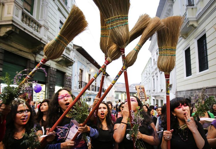 Women hold brooms in the air during a march, called by feminist organizations, against gender violence in Quito, Ecuador. Dolores Ochoa / AP