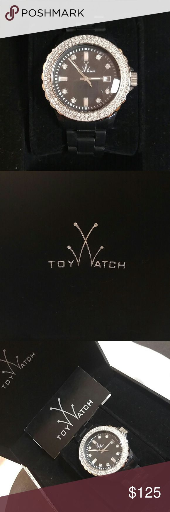 Toywatch large plasteramic Swarovski crystal bezel -EUC💕💯AUTHENTIC! -ORIGINAL BOX,CARD & EXTRA LINK -ALL CRYSTALS IN TACT💯 -worn gently by GIGI📌 -very minor faint scratches in black plasterama but not obvious📌 -faint tiny unnoticeable smudge on face refer to picks its hard to even spot📌 -battery only cost $5 at your trusted jeweler📌 -QUARTZ MOVEMENT/DATE -STAINLESS STELL BACK -WATER RESISTANT 50 METERS -BOX SHOWS NO AGE -PURCHASED MANY YEARS AGO AT NEIMAN MARCUS -REFER TO PHOTO TO SEE…