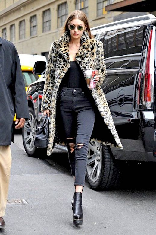 Gigi Hadid is a major supermodel but she was channeling one of the biggest supermodels of them all, Kate Moss. She stepped out in New York wearing a leopard coat, tucked in t-shirt, distressed jeans and super high black heeled boots. This is a look for the books.