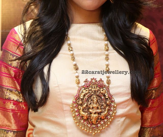 Shivani in Long Chain with Lakshmi Pendant - Jewellery Designs