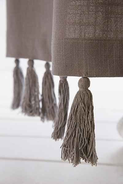 lengthen too-short curtains by adding tassels