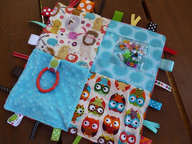 Bright Owls and Hedgehogs Sensory blanket.