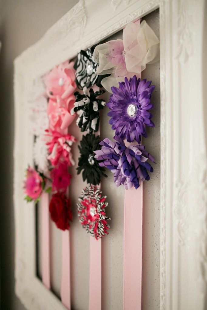Bow holder frame: Frame from Hobby Lobby, painted white, staple and hot glue ribbon onto it. Super easy!