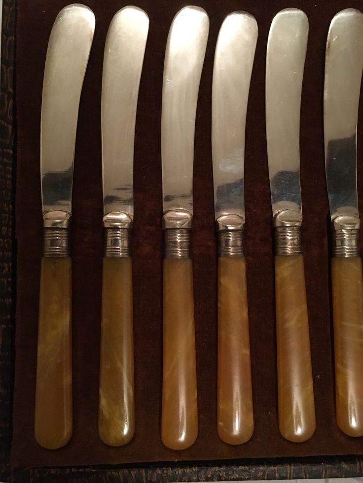 Cu01e Amber coloured tea knives