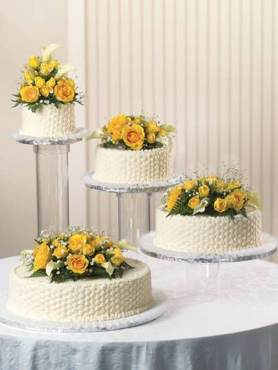 Basket of Flowers. Publix Wedding Cake. Hand-piped basket weave and expert detail make this a simple yet elegant look.