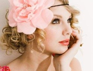 Romantic look, hairstyle for blonde curly hair. Flower in hair. Headband.