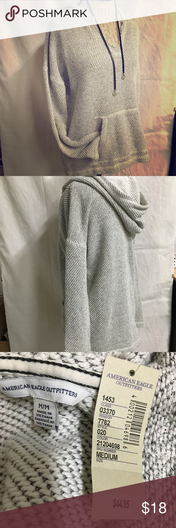 American Eagle pullover hoodie American Eagle Hoodie pullover. Ivory color with gray background size medium. NEW w/tags. American Eagle Outfitters Tops Sweatshirts & Hoodies
