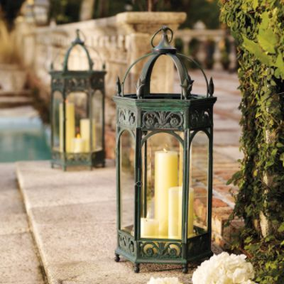 #HolidayDecor Renaissance Garden Lanterns with spruce figs inside to give festive flair for a Christmas lantern. They welcome guests as they light the entry ways with a warm glow.