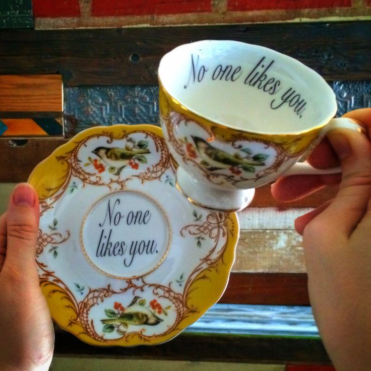 Insult Teacup and Saucer, yellow