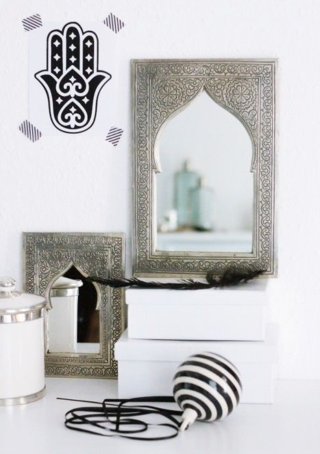 Hand carved Moroccan mirrors next to a Hamsa on the wall! #Hamsa #Moroccan #Decor.