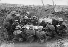 British troops eating their Christmas dinner in a shell hole; Beaumont Hamel, 25th December 1916