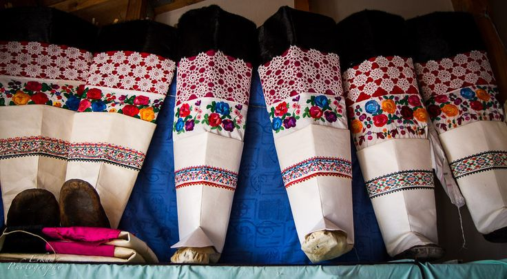 Ceremonial Kamik boots worn by Greenlandic women are made of sealskin, and decorated with lace, embroidery, and avittat (dyed sealskin leather, cut into small pieces and sewn together — the lower border on the boots above).