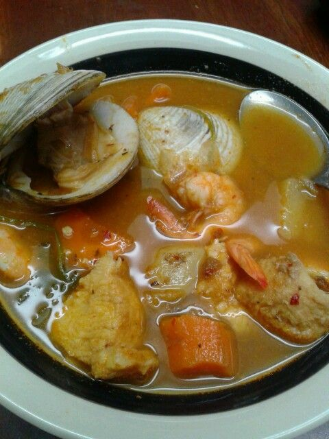 A tasty clam soup with cooked fish.