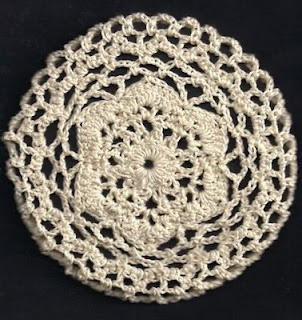 Crocheted Bun Cover - the link goes to the actual crochet pattern for this bun cover.
