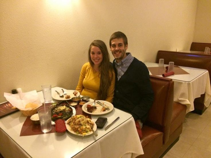 Jill and Derrick Dillard eating some Indian food at a restaurant in their area.