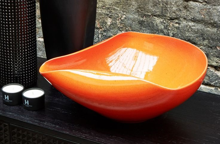 I love to use orange in the home, it has a wonderful way of lifting a room and works beautifully alongside, taupe, black and white. The Orange Pinched Bowl is one of the latest designs from my 'Pinched' family and the high shine finish of the burnt orange glaze complements the smooth shape and form to perfection.