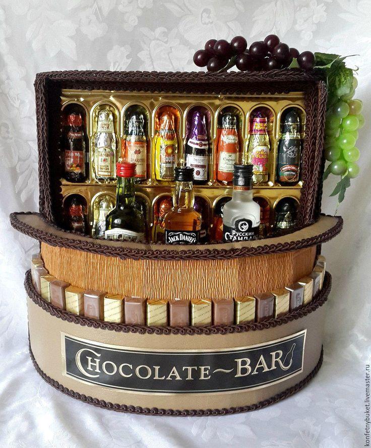Купить или заказать Композиция 'Шокобар' в интернет-магазине на Ярмарке Мастеров. Оригинальный подарок для дорогих мужчин - шоколадный мини-бар. Сегодня в нашей винной карте: набор конфет ' Chocolate - BAR' (с различными коньячными вкусами), виски 'Jack Daniels' (50 мл), виски 'Gren Forest'(50 мл), водка 'Русский стандарт' (50 мл), коробка конфет 'merci'. Возможна замена спиртного по Вашему желанию. Также возможен выбор другой цветовой гаммы по согласованию с заказчиком.