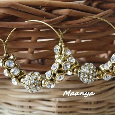 #HoopEarring...  A golden hoop earring embellished with white stone to give you a dazzle look. #maanya https://www.facebook.com/Maanyafashion
