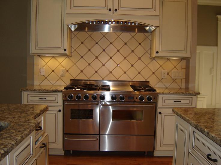 Dove White With Taupe Glaze Kitchen Cabinets. Gallo Napoleone Granite  Countertops. Project Marietta,