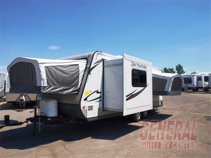 Jayco Jayfeather X23F. When we get a new camper it will be like this! Saw a few at the RV show! Complete with a bathroom and lots of storage :) ahh maybe summer of 2015!