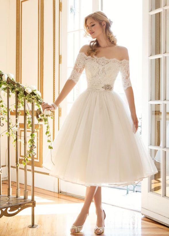 12 Tips For Surviving A Sizzling Summer Wedding: Consider a short wedding dress or light and airy bridesmaid dress, as opposed to the traditional, long versions. Layers of tulle and satin will feel heavy and sticky. A mini dress will keep you cool and moving on the dance floor! Dress by Justin Alexander
