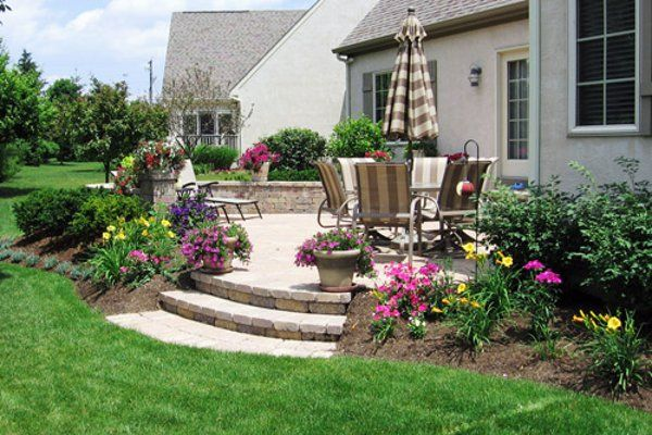 Idea for solving our problem of such a steep drop off with for Patio garden ideas designs