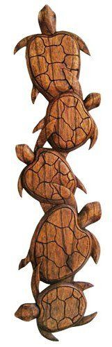 Hawaiian Wood Wall Decoration Five Turtles by Buns of Maui. $56.49. Hawaiian Home Accessories will add a warm tropical touch to your home or office!. Substitute paintings or picture frames on your walls with our Wood Wall Decoration. Put life on those white spaces and add life to your home and converts a simple room to a lively area. This is hand carved from all natural materials. Measures: 25 inch wide by 6 inch high by .5 inch deep.