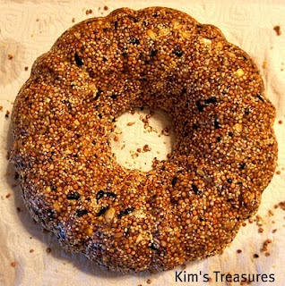 Recipe for a bird seed wreath cake. Tie it up with a big raffia bow, and go!