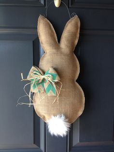 "Easter bunny burlap door hanger - love the simplicity.  No instructions on this one but just look up ""burlap door hanger"" for tutorial."