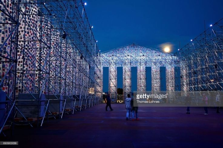 The artwork 'The Parthenon of Books' with donated books by the artist Marta Minujin is illuminated by light and the full moon on June 8, 2017 in Kassel, Germany. The documenta 14 is the fourteenth edition of the art exhibition documenta and will take place 2017 in both Kassel, Germany its traditional home, and Athens, Greece.