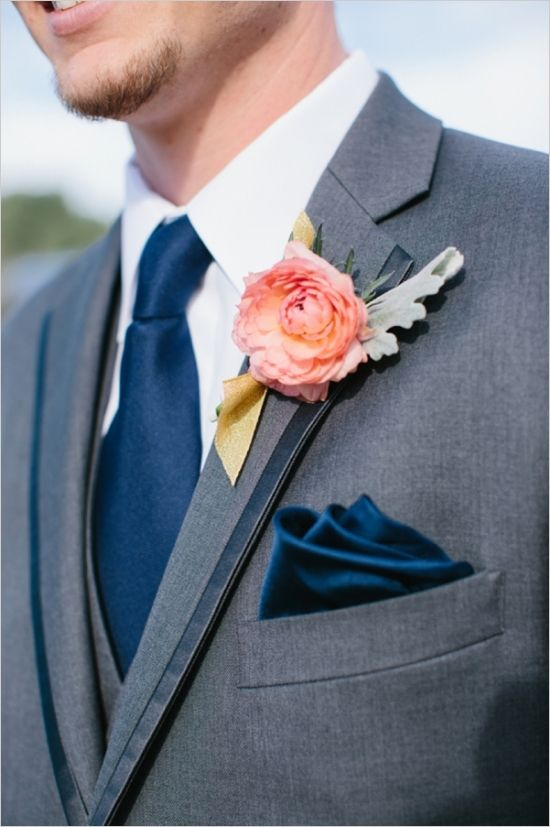 Great colours - grey suit, navy tie and pocket square, peach boutonniere