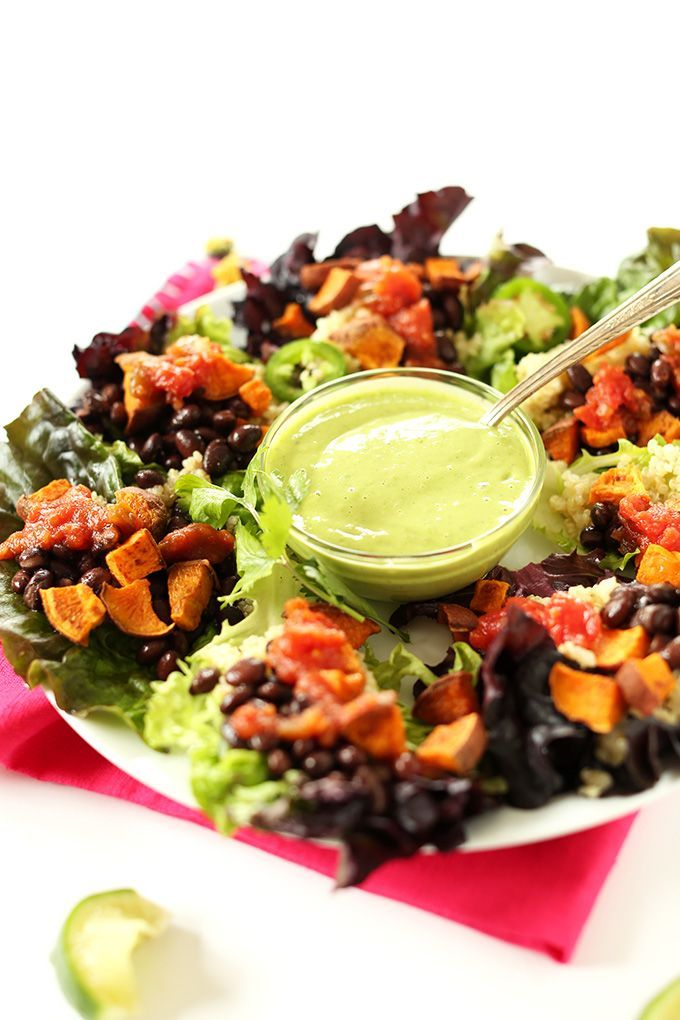 Easy Mexican Quinoa Salad Cups! Lettuce cups, cilantro-lime quinoa, black beans, roasted sweet potatoes and a simple creamy Cilantro Lime Dressing! #vegan #glutenfree