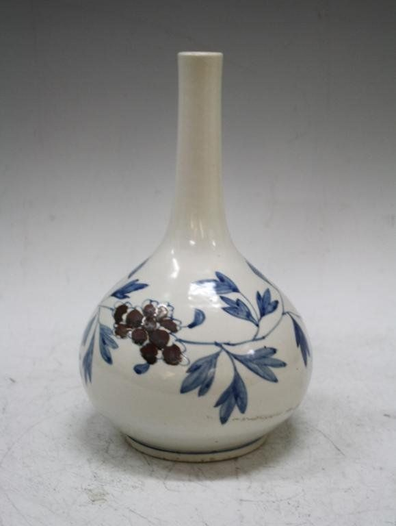 """A Korean bottle vase with a blue and copper red design, late nineteenth century, Korea; unmarked. Dimensions: approximately 12-1/4"""" H x 9"""" diameter."""
