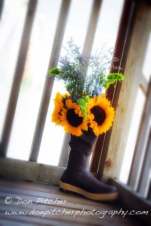 Sunflowers in XtraTuf boot for an Alaska wedding. #alaskawedding #weddingflowers