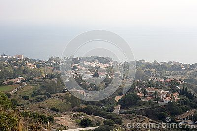 Aerial view upon Benalmadena Spain Andalucia from Stupa. Cloudy weather. Picture taken in december 2015.