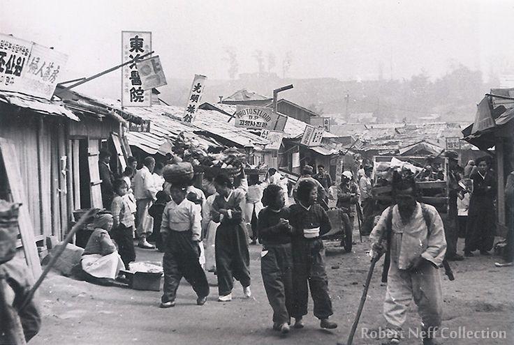 Busy market street in Chuncheon, 1952.