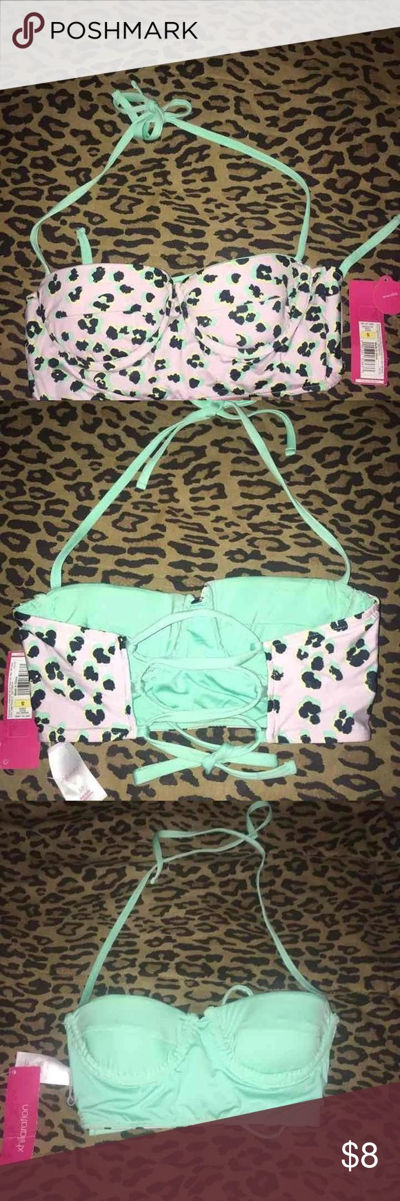 Leopard print mint bikini lace up corset top New with tags bustier style & reversible lace up leopard print bikini top. The top looks white but has a very faint hint of lavender color background. Reverses to all mint. Lightly padded molded cups with underwire. Xhilaration Swim Bikinis
